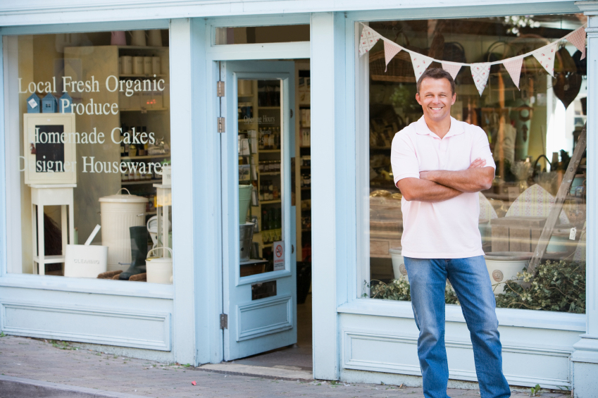 Small Business Owner in front of Shop