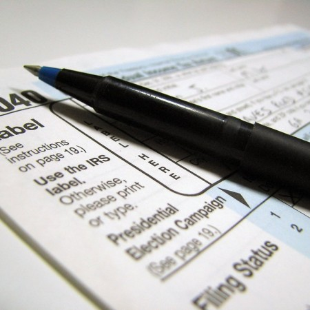 2481-closeup-of-a-1040-tax-form-and-a-pen-pv